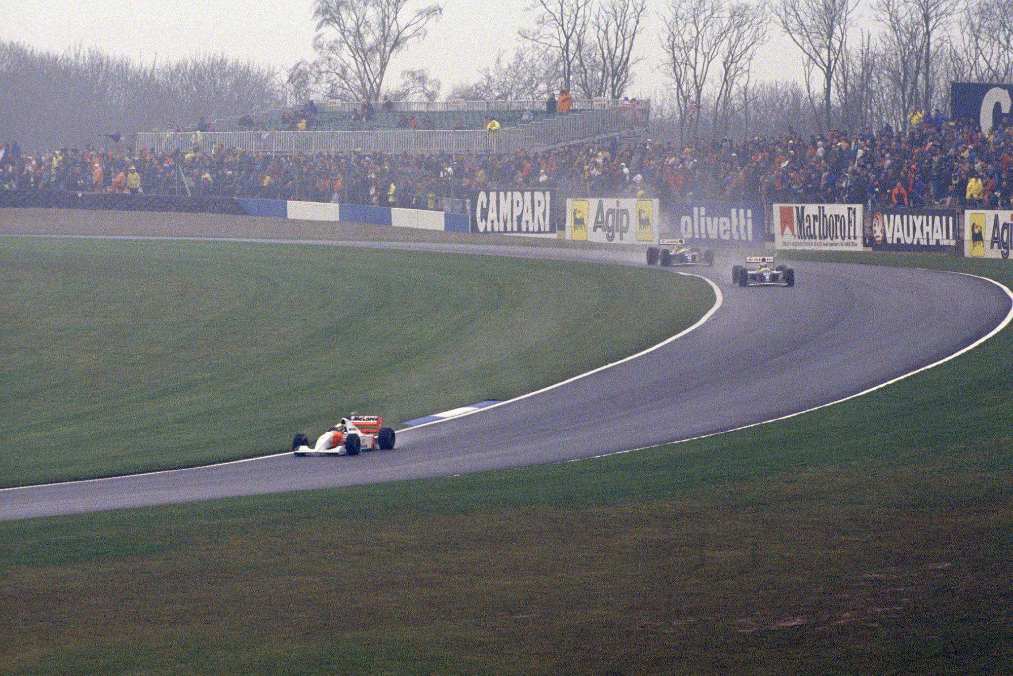 Ayrton Senna pulls out a lead at the 1993 European Grand Prix at Donington