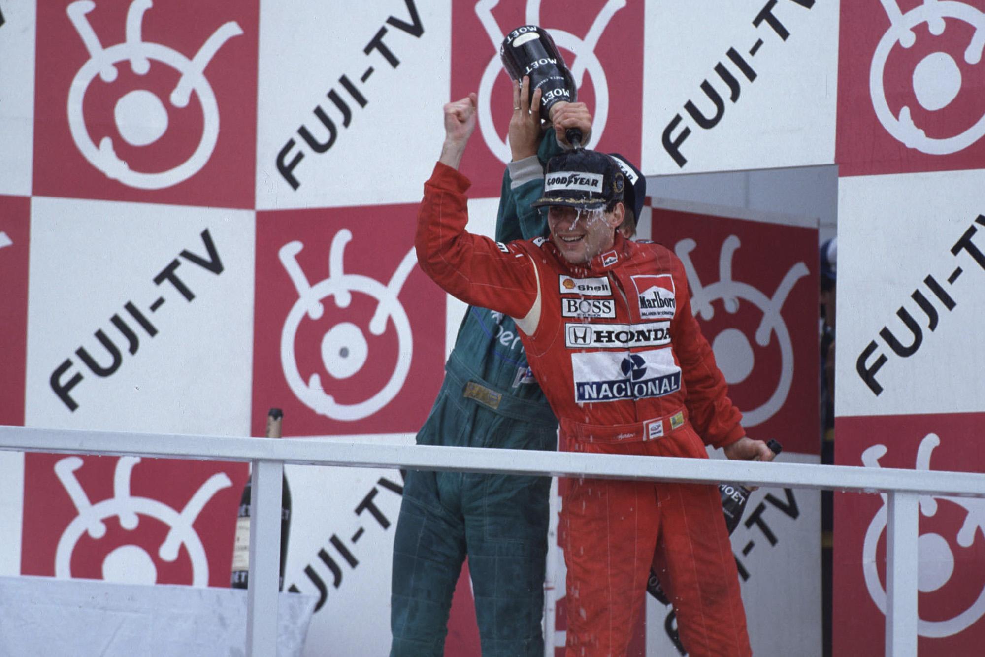 Ayrton Senna celebrates winning his first F1 world championship at the 1988 Japanese Grand Prix
