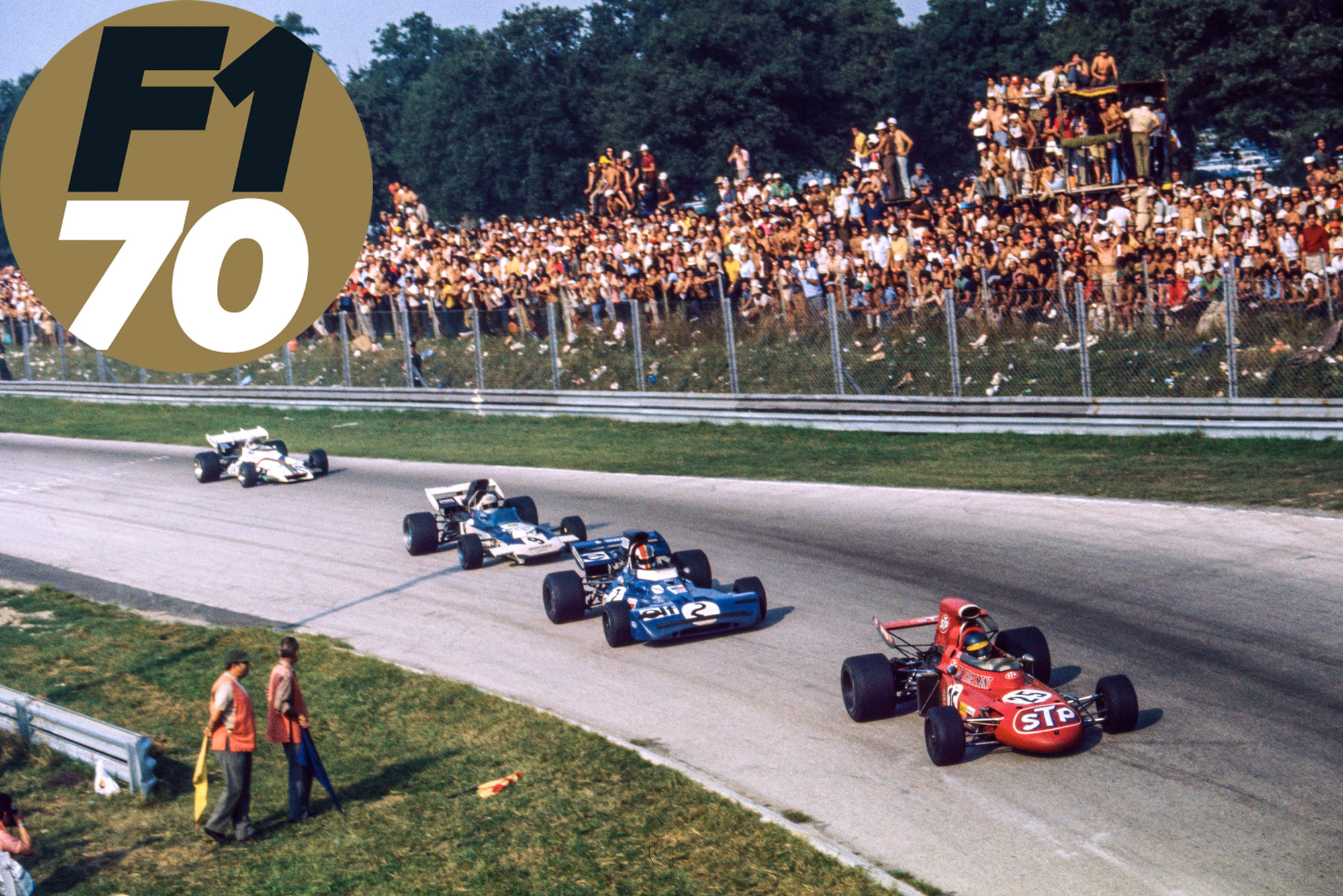 Ronnie Peterson's March leads Francois Cevert's Tyrrell and Mike Hailwood's Surtees in the 1971 F1 Italian Grand Prix at Monza