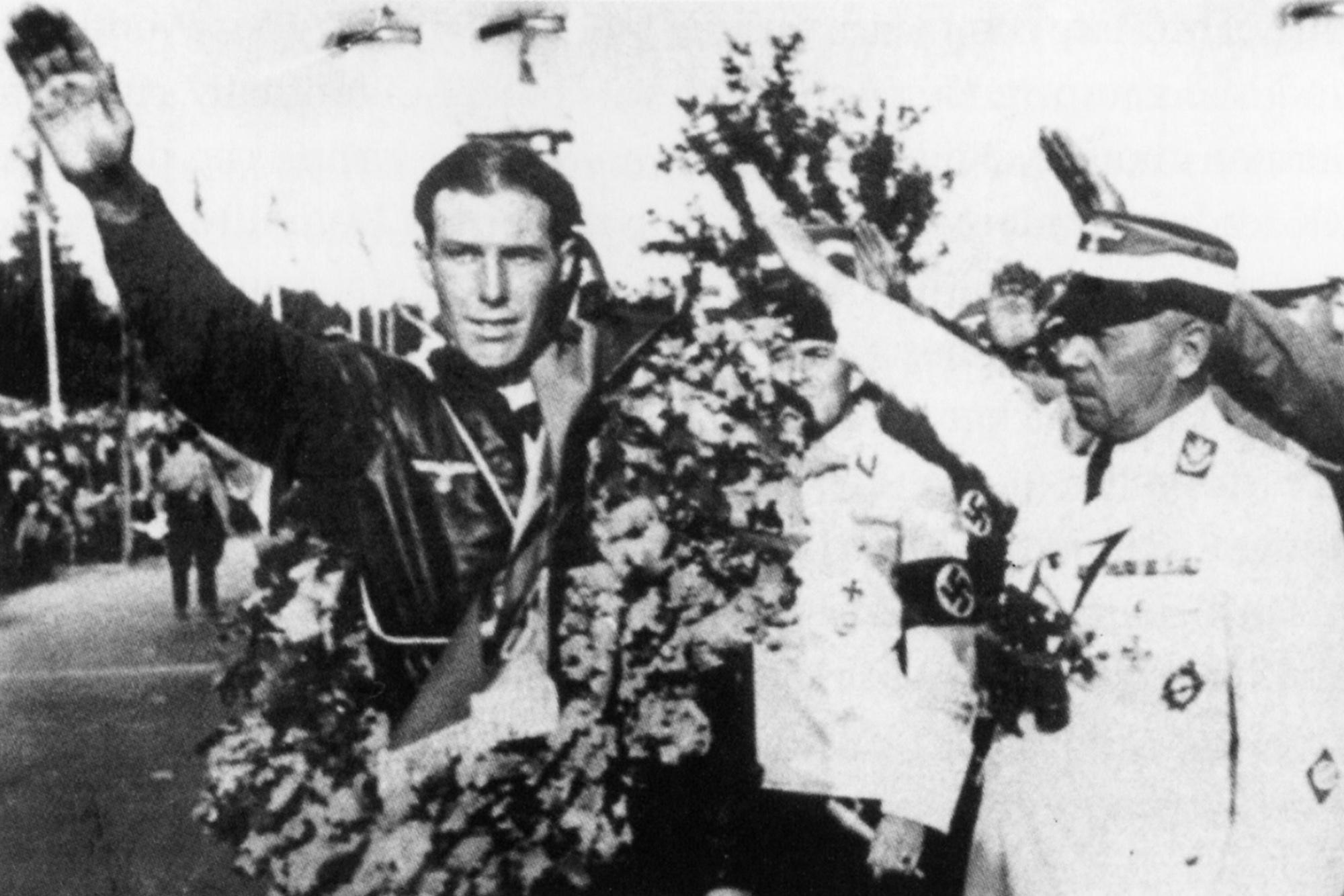 Georg Meier salutes alongside Adolf Huhnlein