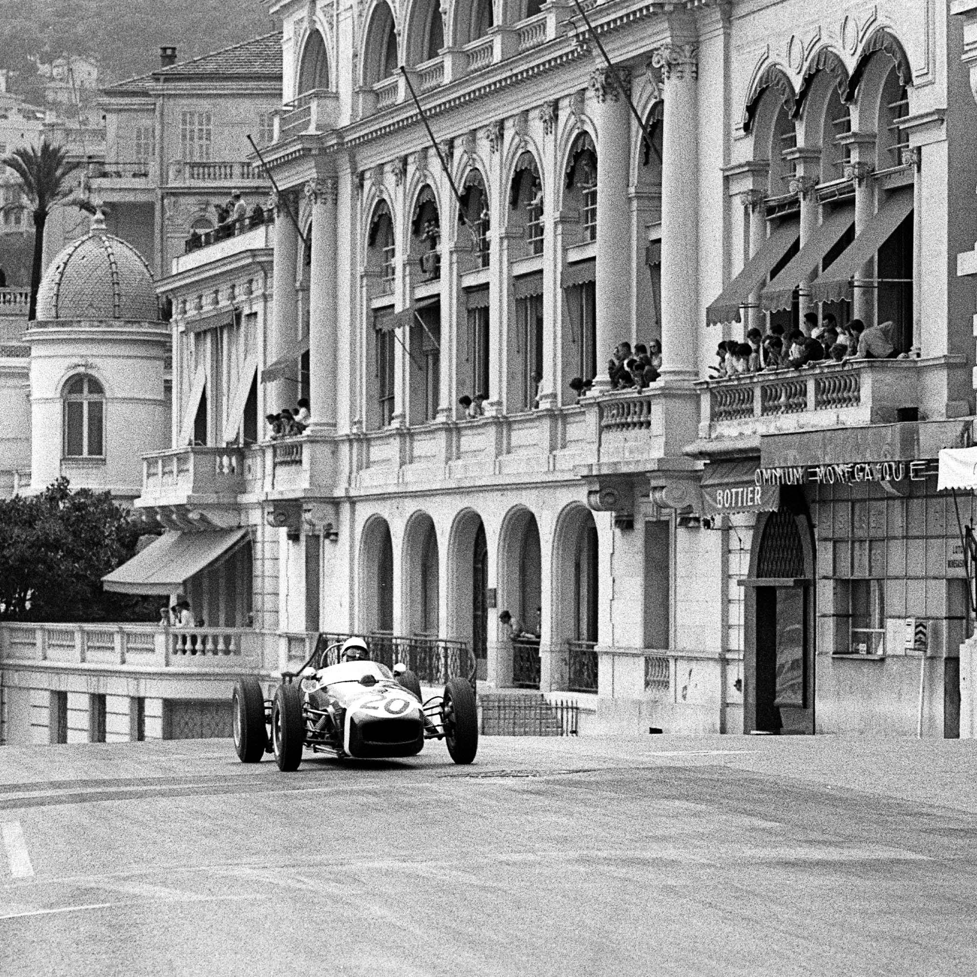 Stirling Moss up the hill at Monaco in 1961 square