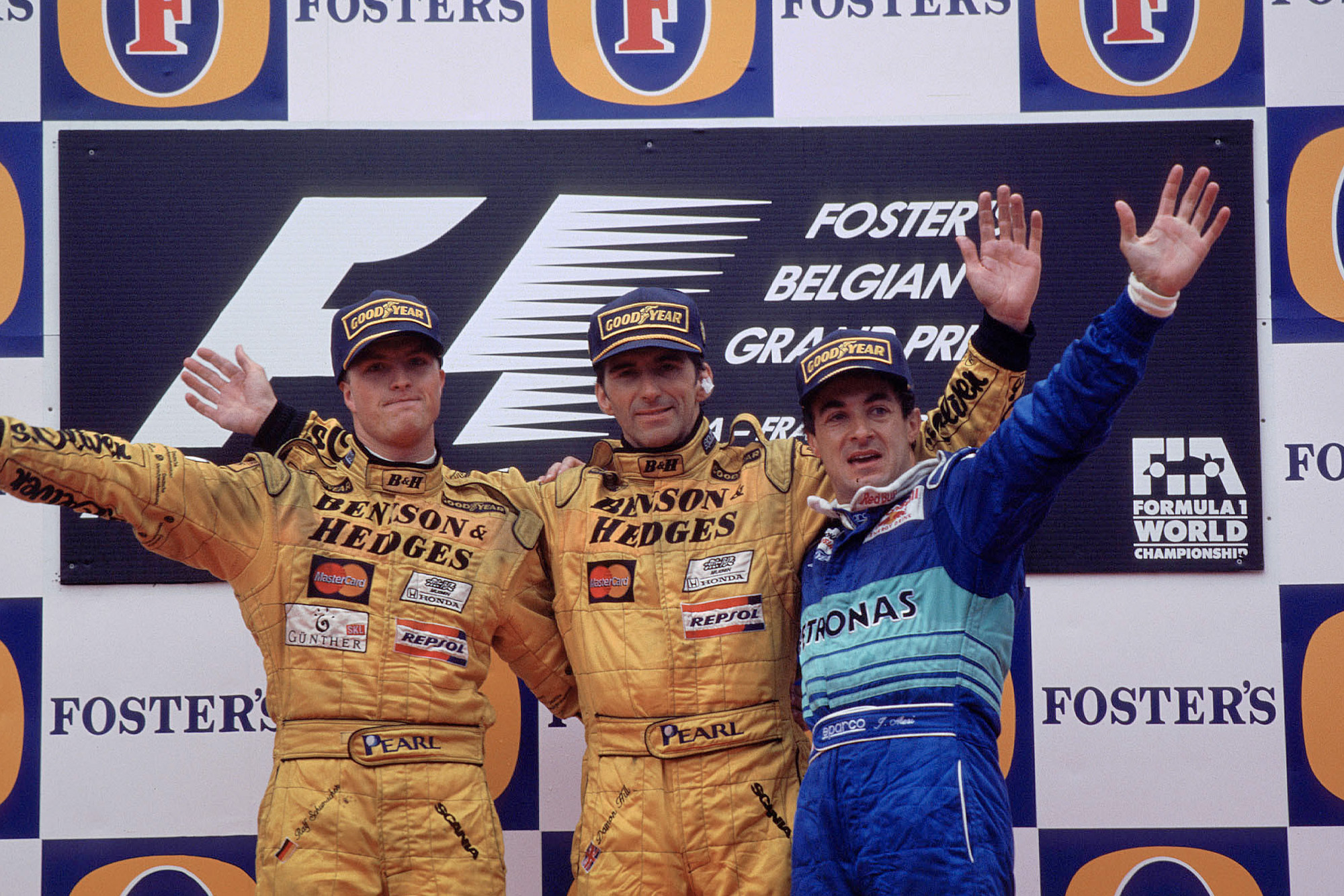 Damon Hill at the top of the podium with Ralf Schumacher and Jean Alesi after the 1998 Belgian Grand Prix
