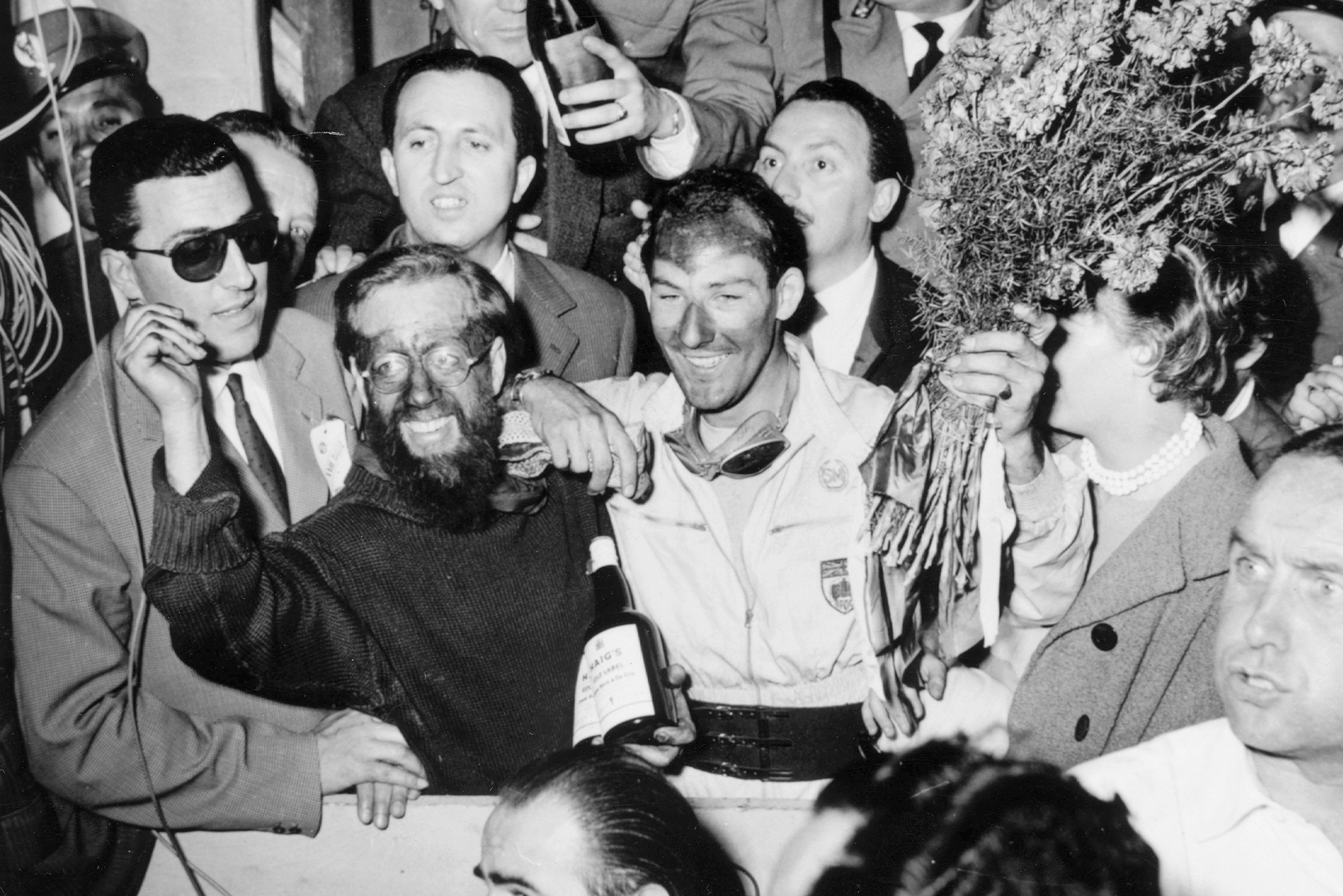 Stirling Moss and Denis JEnkinson celebrate victory in the 1955 Mille Miglia
