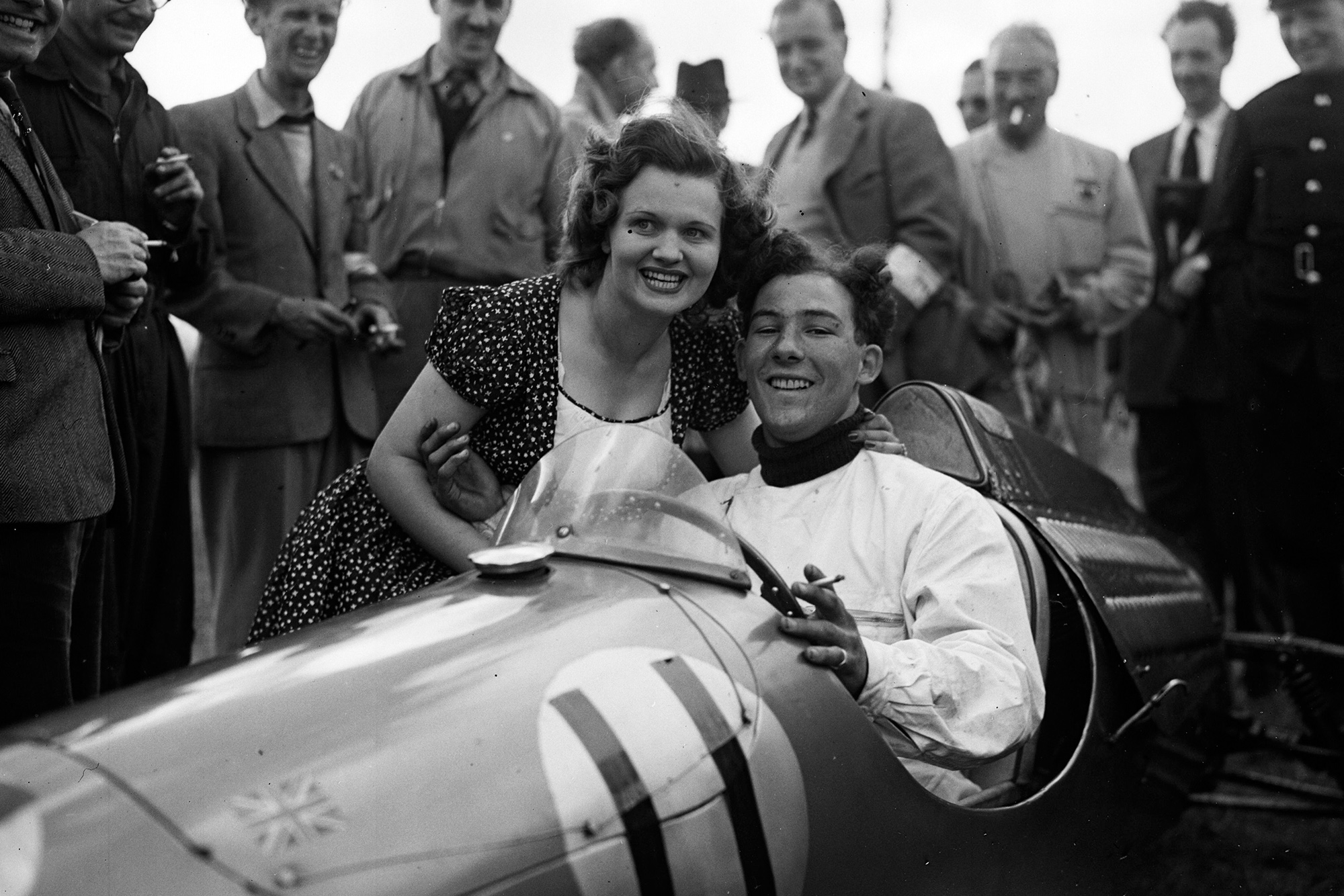 Stirling Moss after a victory in August 1950
