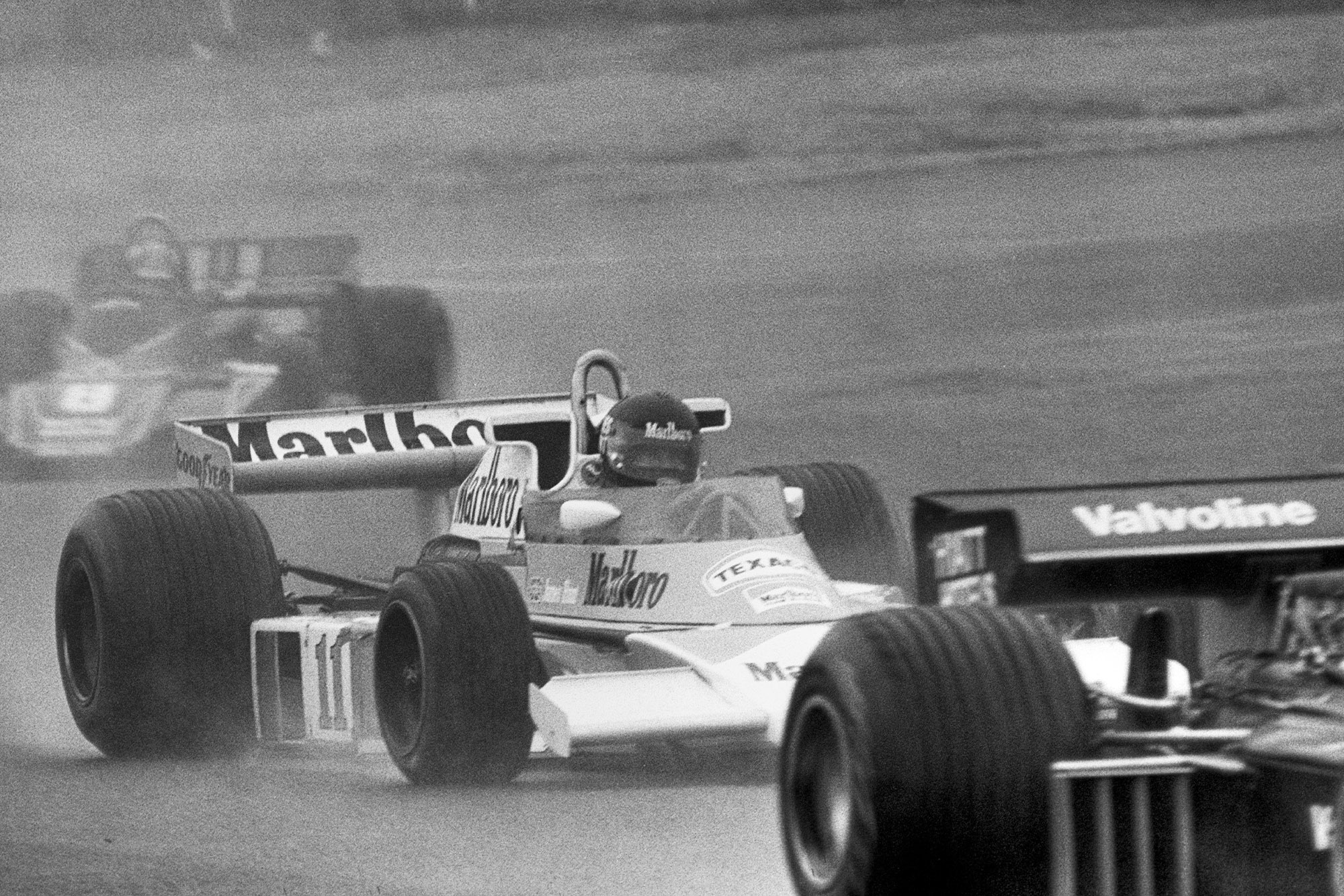 James Hunt battles through the traffic in the 1976 Japanese Grand Prix