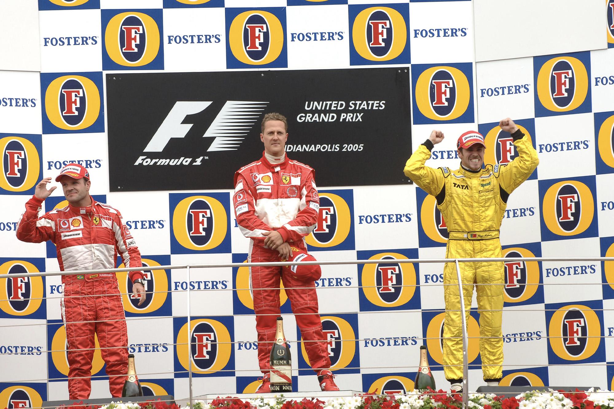 Tiago Monteiro alongside Michael Schumacher and Rubens Barrichello on the podium at the 2005 US Grand Prix