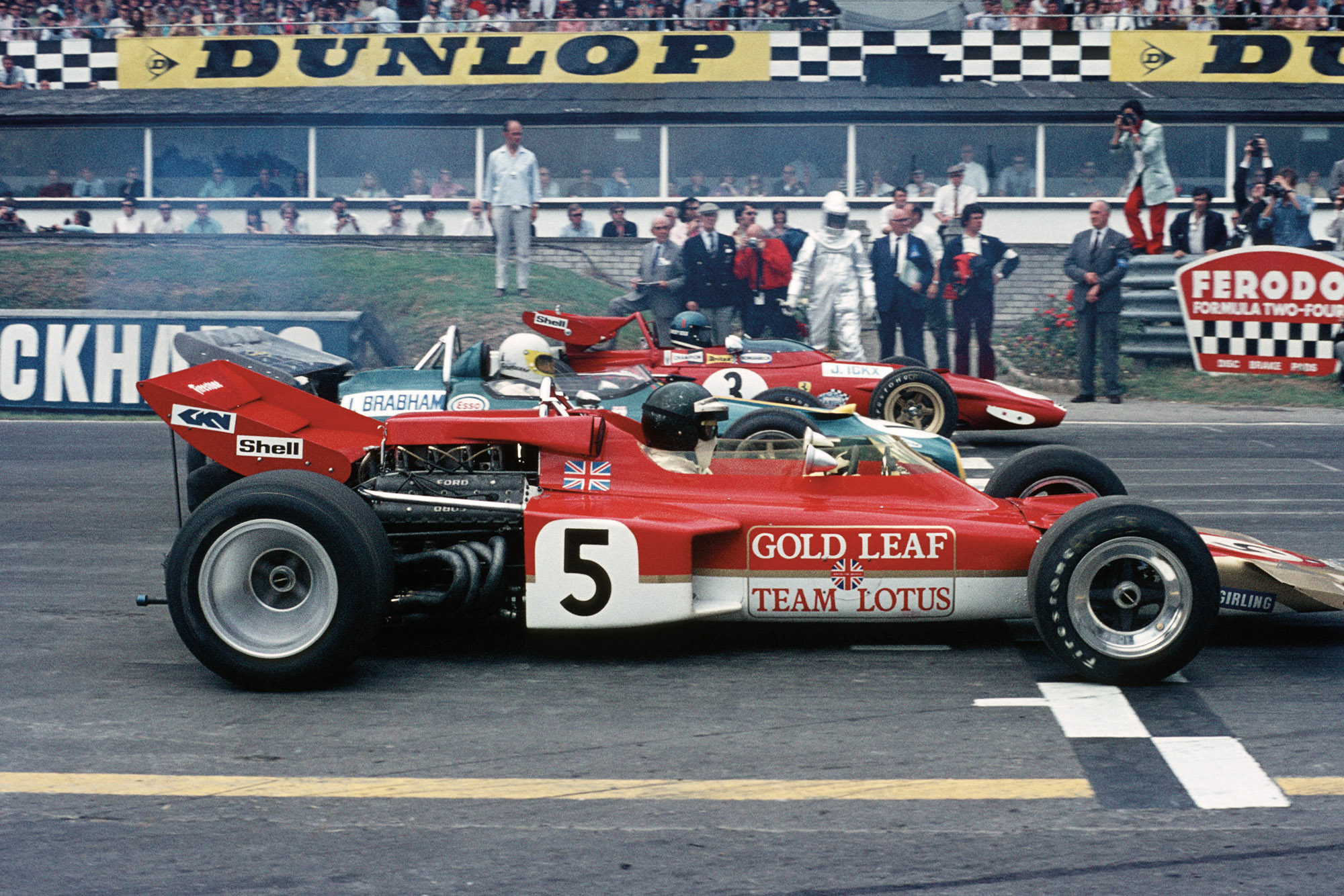 Jochen Rindt Jack Brabham and Jacky Ickx on the Brands Hatch grid at the 1970 F1 Brtish Grand Prix