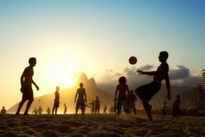 Playing football on Ipanema Beach, Rio de Janeiro