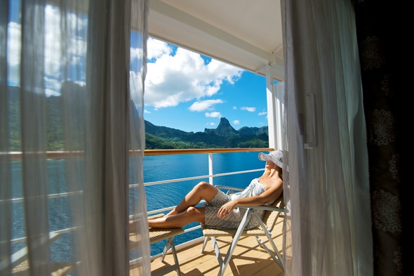 Relaxing on the balcony on a Paul Gauguin cruise