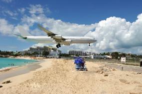 Plane landing over Maho Bay, St Maarten