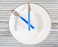 plate clock with knife and fork