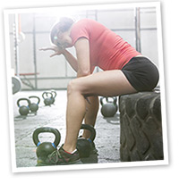 woman trainer tired in the gym