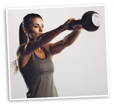 Woman Using Kettlebells