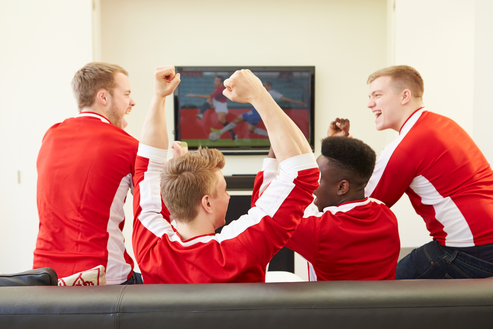 Men watching football on the television