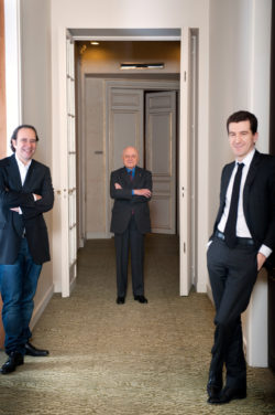 Xavier Niel, Pierre Bergé, and Mathieu Pigasse, Fondation Pierre Bergé-Yves Saint Laurent, 5 avenue Marceau, Paris, January 27, 2011. Photograph by Martin Bureau., © AFP