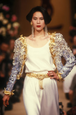 "Evening ensemble, known as ""Homage to My House,"" worn by Ariane Koizumi during the fashion show for the spring-summer 1990 haute couture collection, Salon impérial of the Hôtel Inter-Continental, Paris, January 1990. Photograph by Guy Marineau., © Musée Yves Saint Laurent Paris / Guy Marineau"