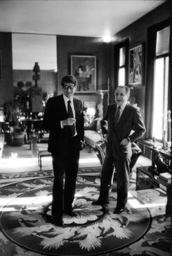 Yves Saint Laurent and Pierre Bergé in their apartment, the grand salon at 55 rue de Babylone, Paris, 1982. Photograph by Vladimir Sichov., © Succession Picasso 2017