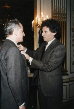 Pierre Bergé decorated with the medal of Chevalier de Légion d'honneur by Jack Lang, Paris, March 29, 1985., © Droits Réservés