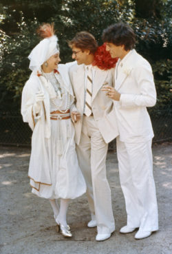 Yves Saint Laurent flanked by the bride and groom Loulou de La Falaise and Thadée Klossowski, Chalet des Îles, Bois de Boulogne, Paris, 1977. Photograph by Guy Marineau., © Musée Yves Saint Laurent Paris / Guy Marineau