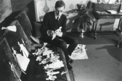 Yves Saint Laurent and his paper dolls, Paris, 1957. Photograph by François Pagès., © François PAGES/PARISMATCH/SCOOP