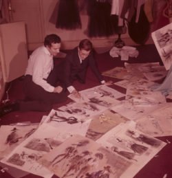 Roland Petit and Yves Saint Laurent looking at costume sketches for the ballet Cyrano de Bergerac, House of Christian Dior, 30 avenue Montaigne, Paris, 1959. Photograph by Maurice Jarnoux., © Maurice JARNOUX/PARISMATCH/SCOOP