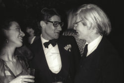 Yves Saint Laurent and Andy Warhol at a party, Paris, 1979. Photograph by Guy Marineau., © Musée Yves Saint Laurent Paris / Guy Marineau