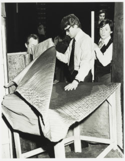 Preparations for the set decoration with Yves Saint Laurent, Hector Pascual (on the couturier's right), and the crew of L'Aigle à deux têtes (The Eagle with Two Heads), Théâtre de l'Athénée-Louis Jouvet, Paris, 1978., © Droits Réservés