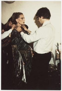 Edwige Feuillère and Yves Saint Laurent during a fitting for the Queen's gown, Act I of L'Aigle à deux têtes (The Eagle with Two Heads), Théâtre de l'Athénée-Louis Jouvet, Paris, 1978., © Droits Réservés