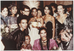 Yves Saint Laurent surrounded by his models after the fashion show for the autumn-winter 1983 haute couture collection, which included a preview presentation of his fragrance Paris, Hôtel Inter-Continental, Paris, July 1983, © Droits Réservés