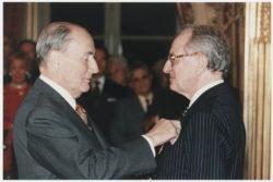 François Mitterrand awarding Pierre Bergé the medal of Officier de la Légion d'honneur, Palais de l'Elysée, Paris., © Droits Réservés