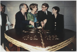 Pierre Bergé, Catherine Deneuve, Yves Saint Laurent, and Zizi Jeanmaire cutting the cake for the thirtieth anniversary of the haute couture house, Opéra Bastille, Paris, February 3, 1992., © Droits Réservés