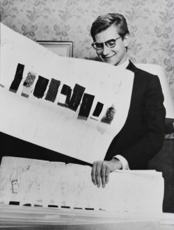 Yves Saint Laurent with his collection boards for the house of Christian Dior, Paris, 1960. Photograph by André Ostier., © Les ayants droit d'André Ostier