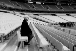 Pierre Bergé in the stands of the Stade de France during preparations for the retrospective fashion show, Saint-Denis, July 12, 1998. Photograph by Guy Marineau., © Musée Yves Saint Laurent Paris / Guy Marineau