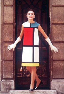 Cocktail dress worn by Muriel, homage to Piet Mondrian, autumn-winter 1965 haute couture collection, Paris, July 1965. Photograph by Louis Dalmas., © DALMAS/SIPA
