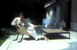 Yves Saint Laurent in his garden, 55 rue de Babylone, Paris, 1978. Photograph by Guy Marineau., © Musée Yves Saint Laurent Paris / Guy Marineau