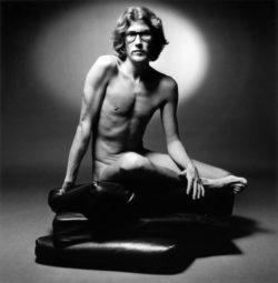 Yves Saint Laurent posing nude in the ad for his first eau de toilette Pour Homme, 1971., © The Estate of Jeanloup Sieff