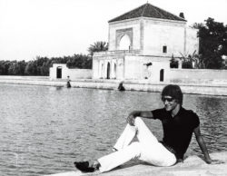Yves Saint Laurent in front of the Menara Gardens, Marrakech, 1960s. Photograph by Pierre Bergé., © Pierre Bergé