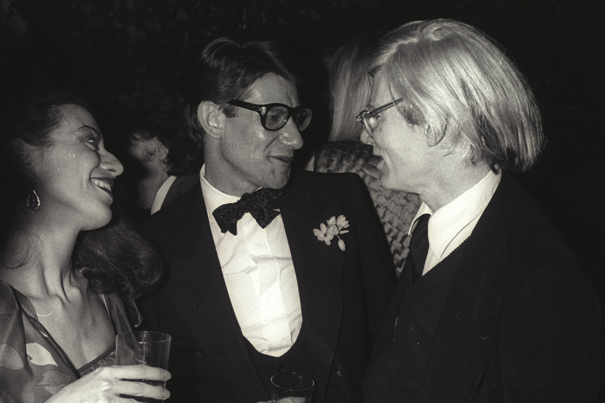a389241ab598f Yves Saint Laurent and Andy Warhol at a party, Paris, 1979. Photograph by  Guy Marineau. © Musée Yves Saint Laurent Paris / Guy Marineau