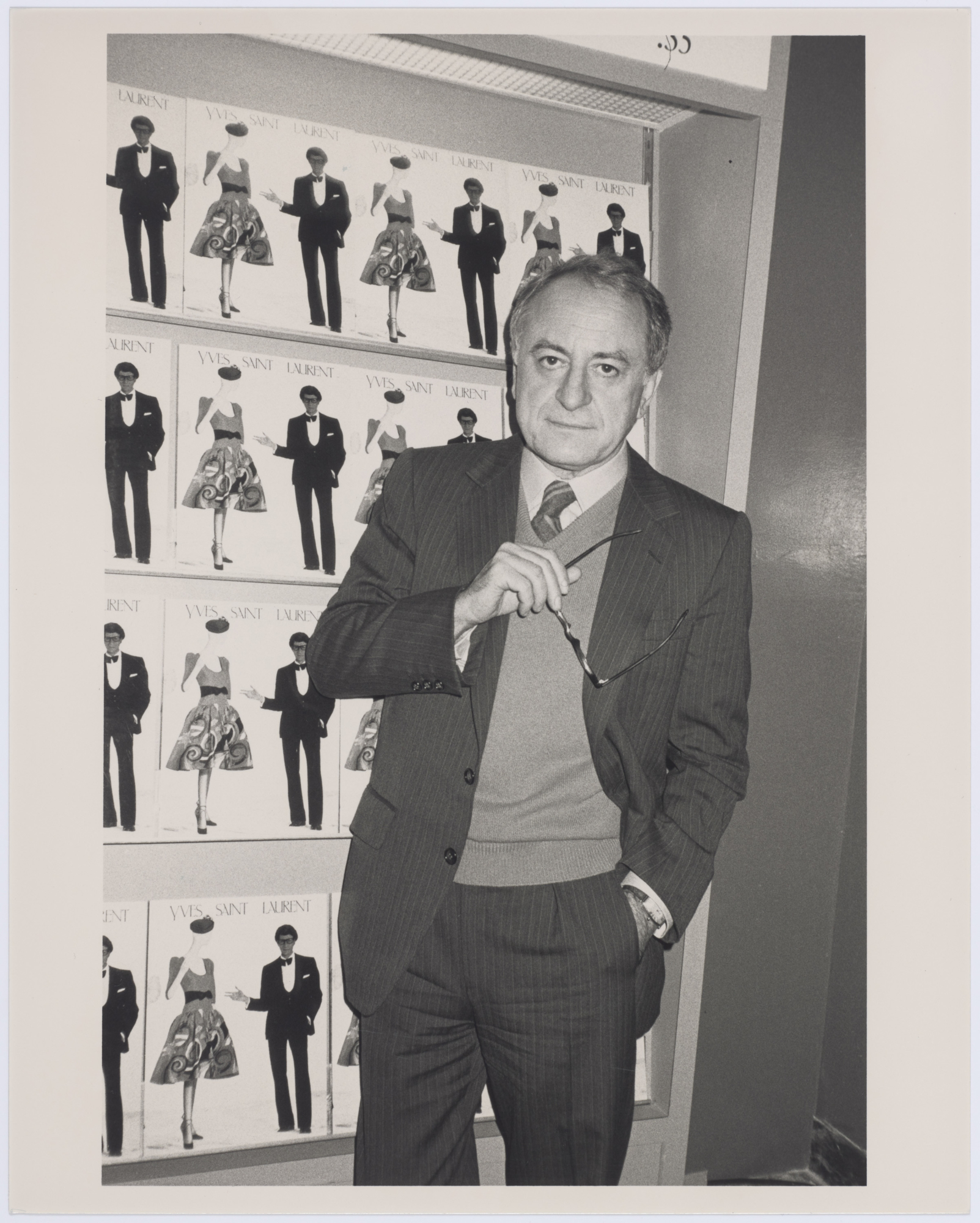 277c8a2d22a Pierre Bergé in the boutique for the exhibition devoted to Yves Saint  Laurent, Metropolitan Museum, New York, December 1983. Photograph by  Roxanne Lowit.