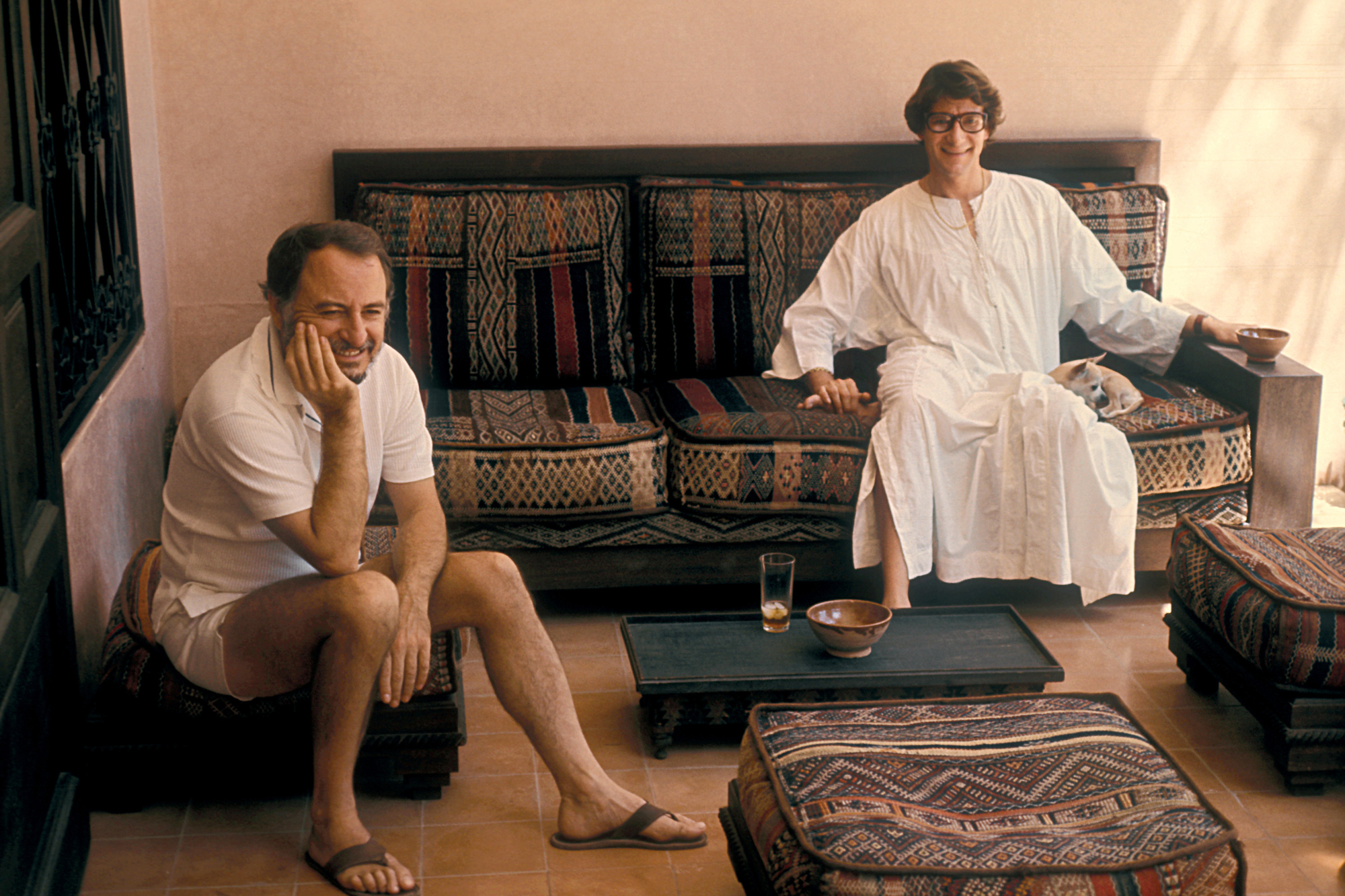 dcf8f00fb99 Pierre Bergé and Yves Saint Laurentin their house Dar Es Saada, Marrakech,  1977. Photograph by Guy Marineau. © Musée Yves Saint Laurent Paris / Guy  Marineau