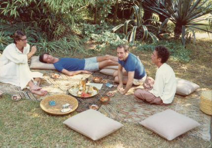 Yves Saint Laurent, Jacques Grange, Pierre Bergé, and Fernando Sanchez in the garden of Dar es Saada, Marrakech, end of the 1970s. Photograph by François-Marie Banier., © François-Marie Banier