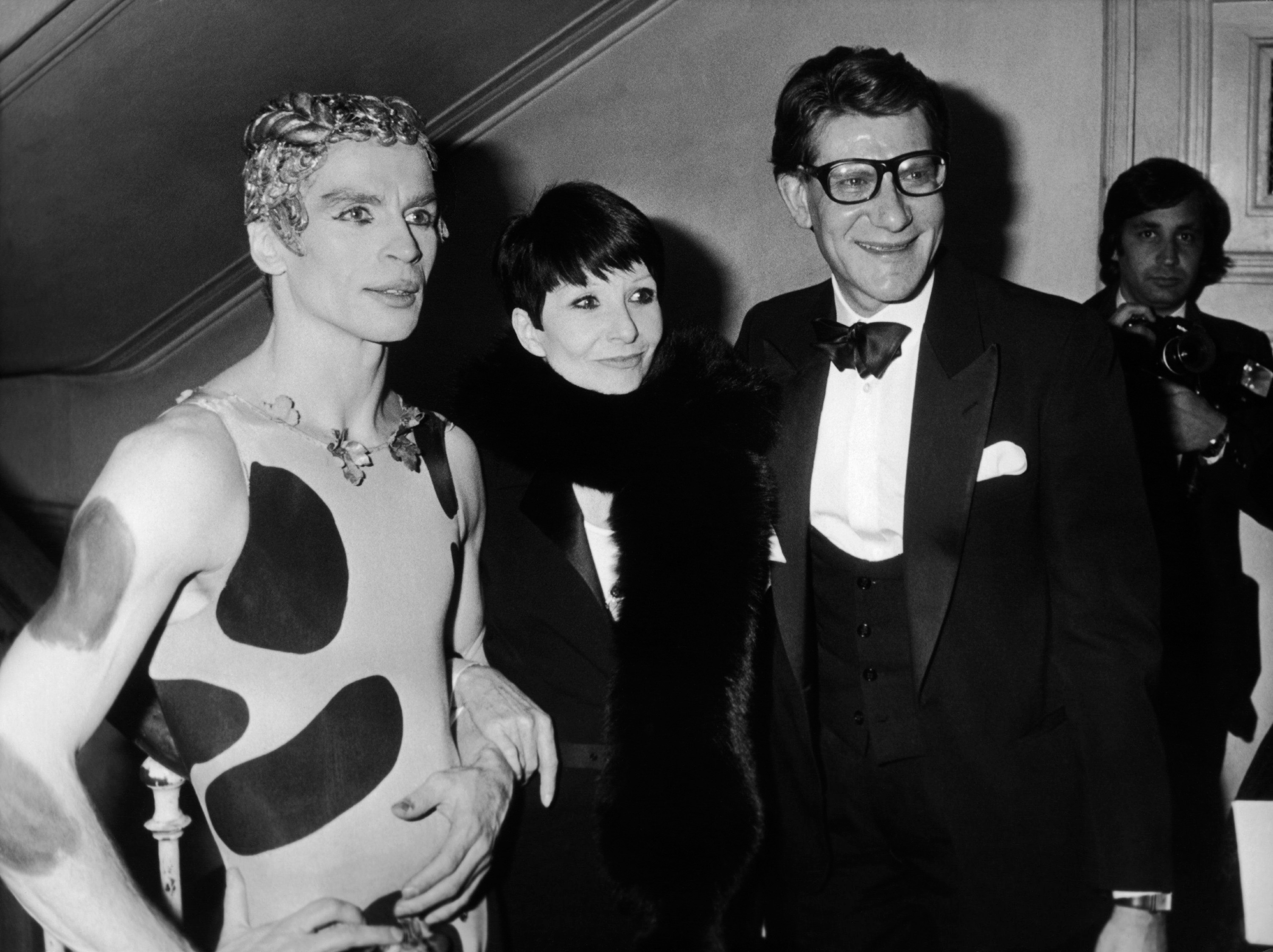 Rudolf Nureyev, Zizi Jeanmaire, and Yves Saint Laurent at the launch of the  fragrance Kouros, Opéra-Comique, Paris, February 23, 1981.