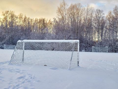 Md depositphotos 61339633 stock photo snowy soccer field