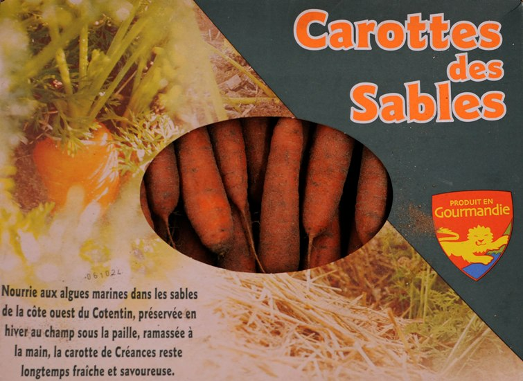 Sand-grown carrots in a box
