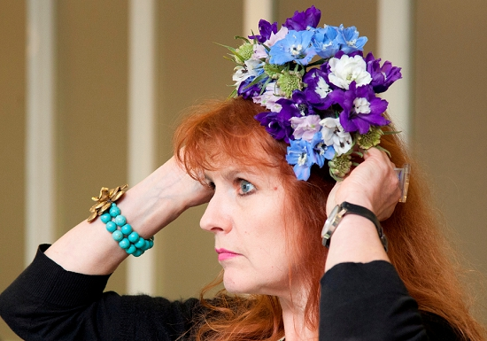 Delphinium flowers in a headdress modelled by Anthea Duncan