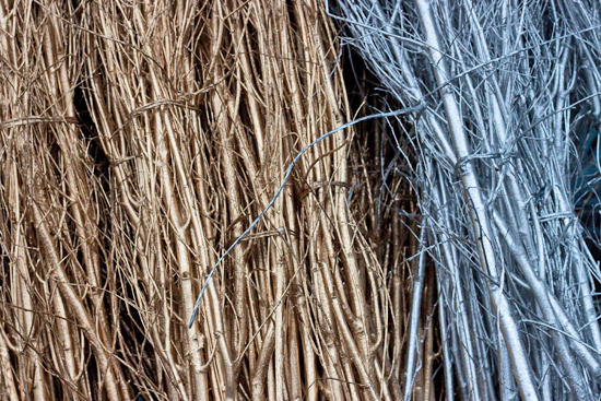 Gold and silver painted and sparkly twigs at New Covent Garden Flower Market - Christmas 2013