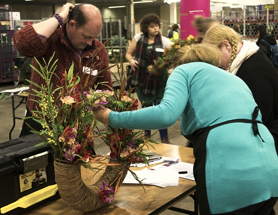 Teams at work in the competition at New Covent Garden Flower Market College Day - 2014