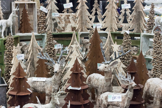 Wooden Christmas trees and reindeer at New Covent Garden Flower Market - Christmas 2015