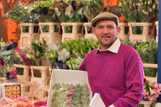 Edwin at Dennis Edwards showing off cut succulents at New Covent Garden Flower Market