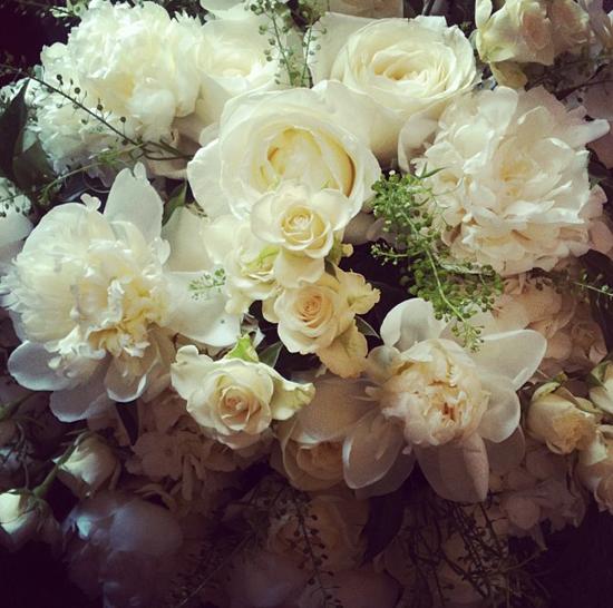 Euphoric Flowers designs using white and cream roses